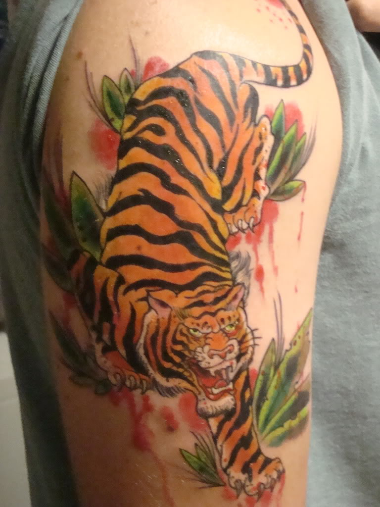 53 japanese tiger tattoos and ideas japanese tiger tattoo on half sleeve for men izmirmasajfo