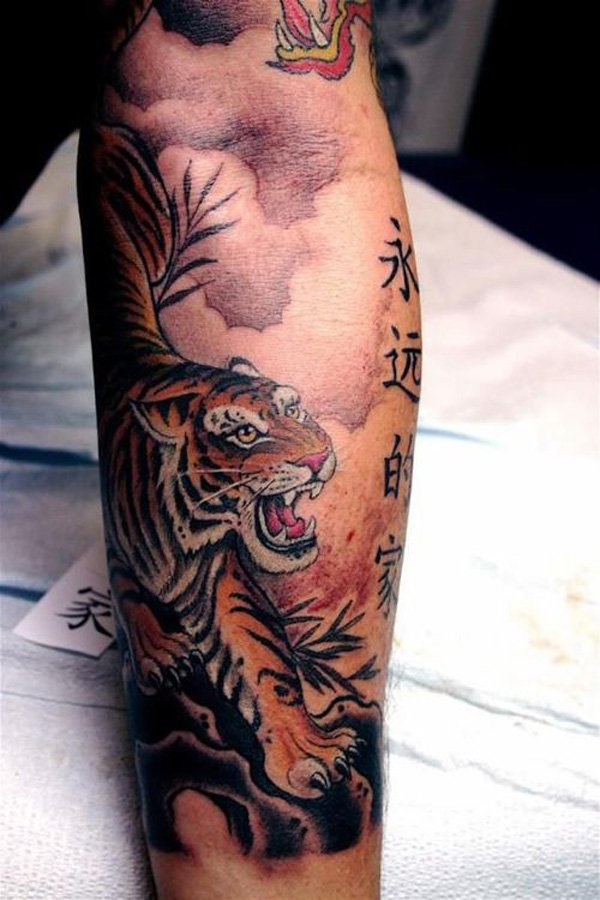 536a687e306d6 Kanji Symbols And Tiger Tattoo On Arm Sleeve