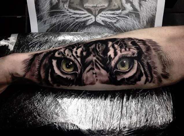 Tiger eyes tattoos lower back - photo#24