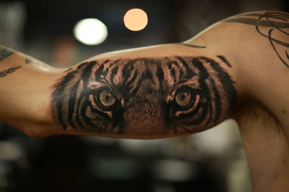 Tiger eyes tattoos lower back - photo#19