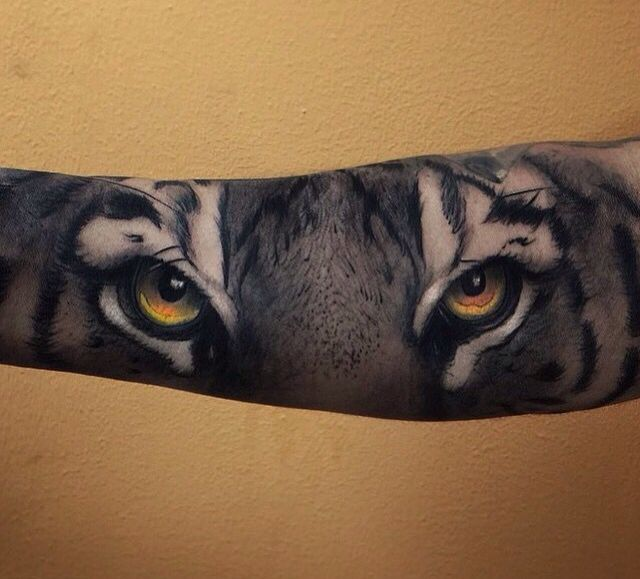Tiger eyes tattoos lower back - photo#23