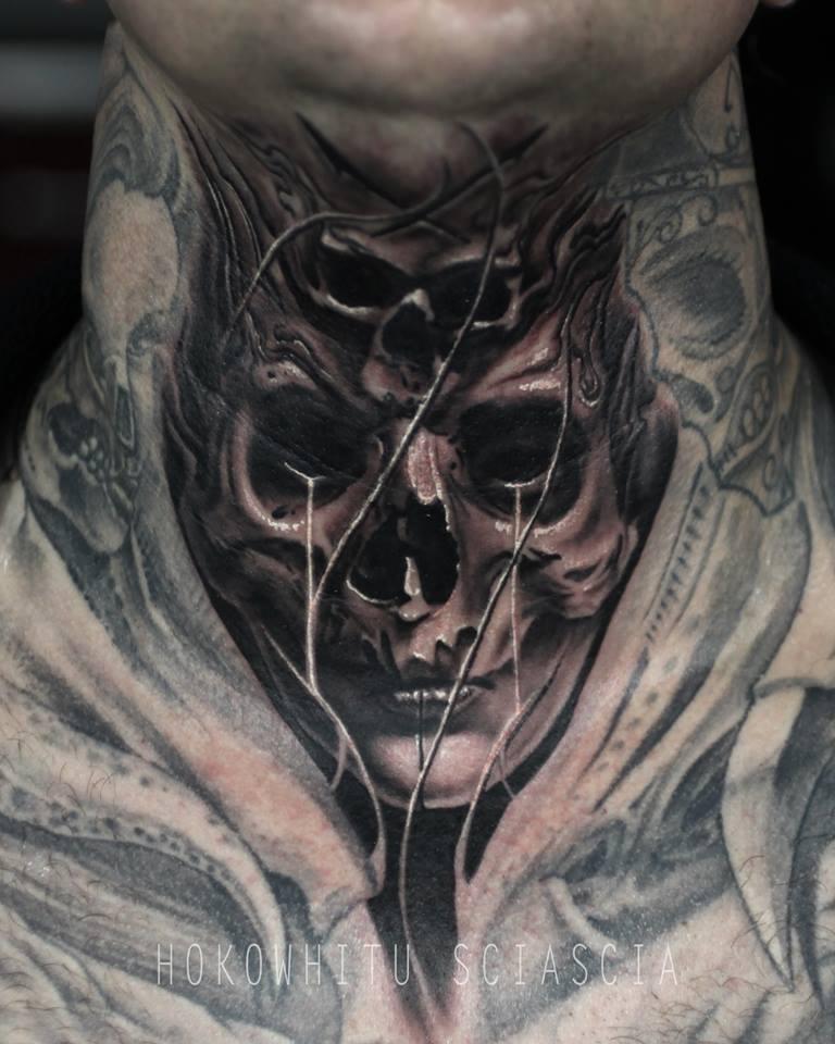Unique black ink skull tattoo on man neck for Skull neck tattoos