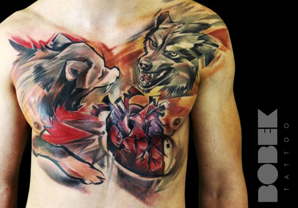 Abstract Two Wolfs With Real Heart Tattoo On Man Chest