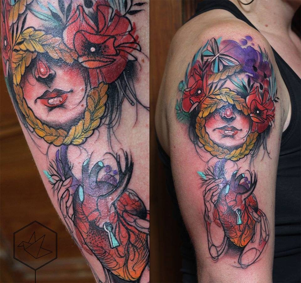 Abstract Women Face With Real Heart Tattoo On Right Half Sleeve