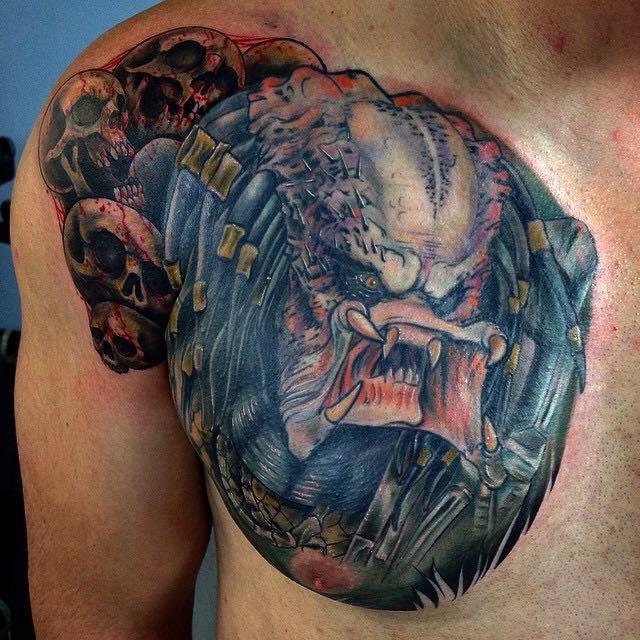 Alien Head Tattoo On Man Right Chest By Pig Legion