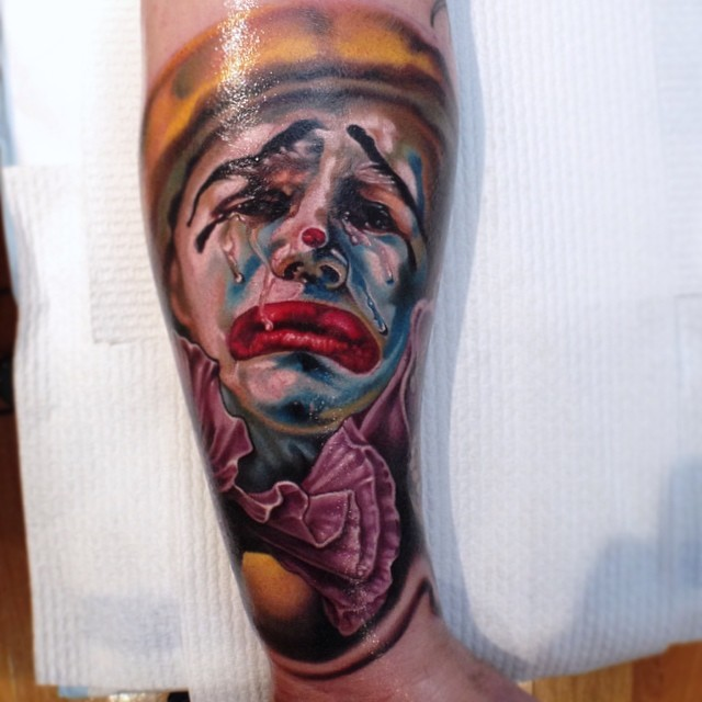 Attractive 3D Crying Clown Head Tattoo On Forearm