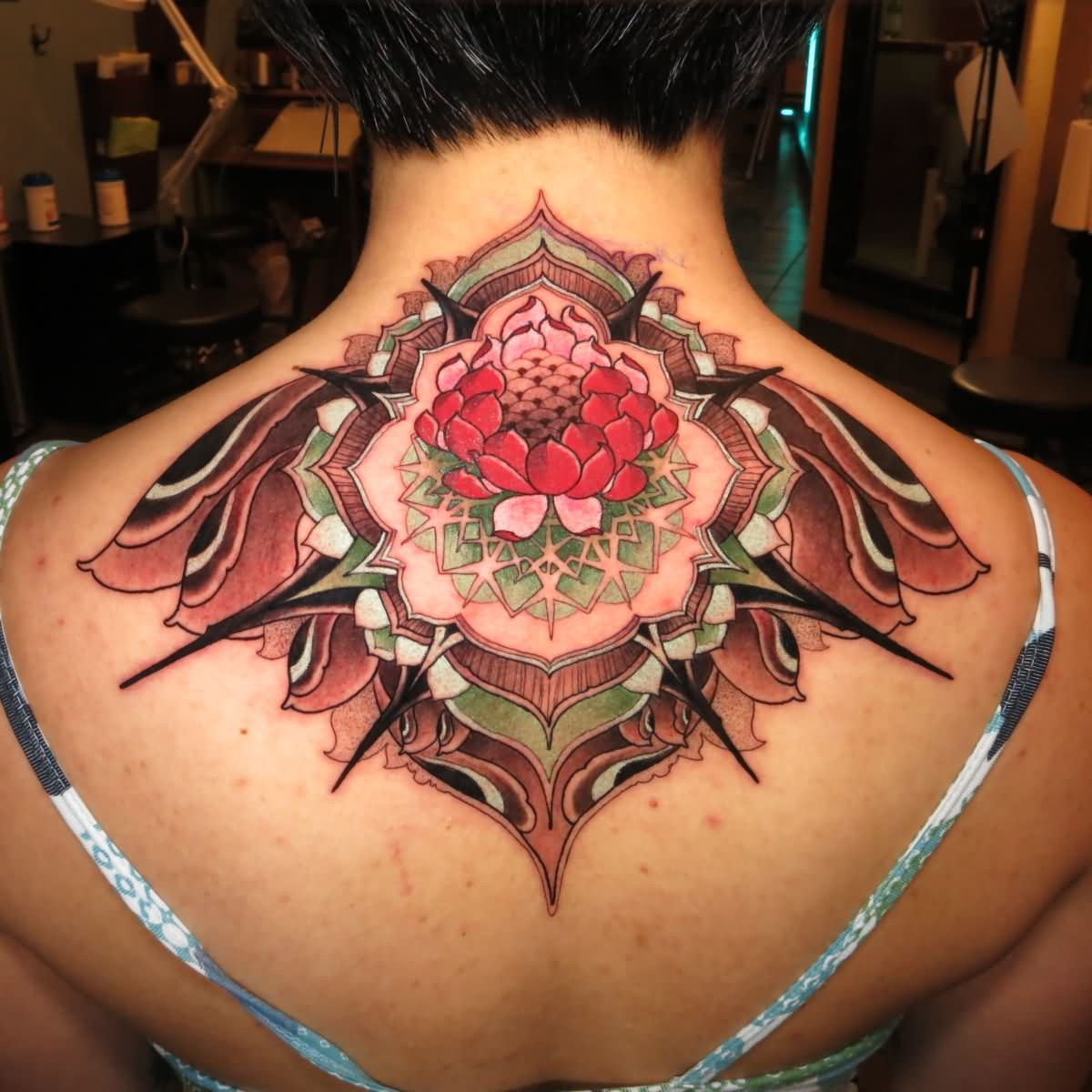 Awesome traditional lotus flower tattoo on women upper back izmirmasajfo