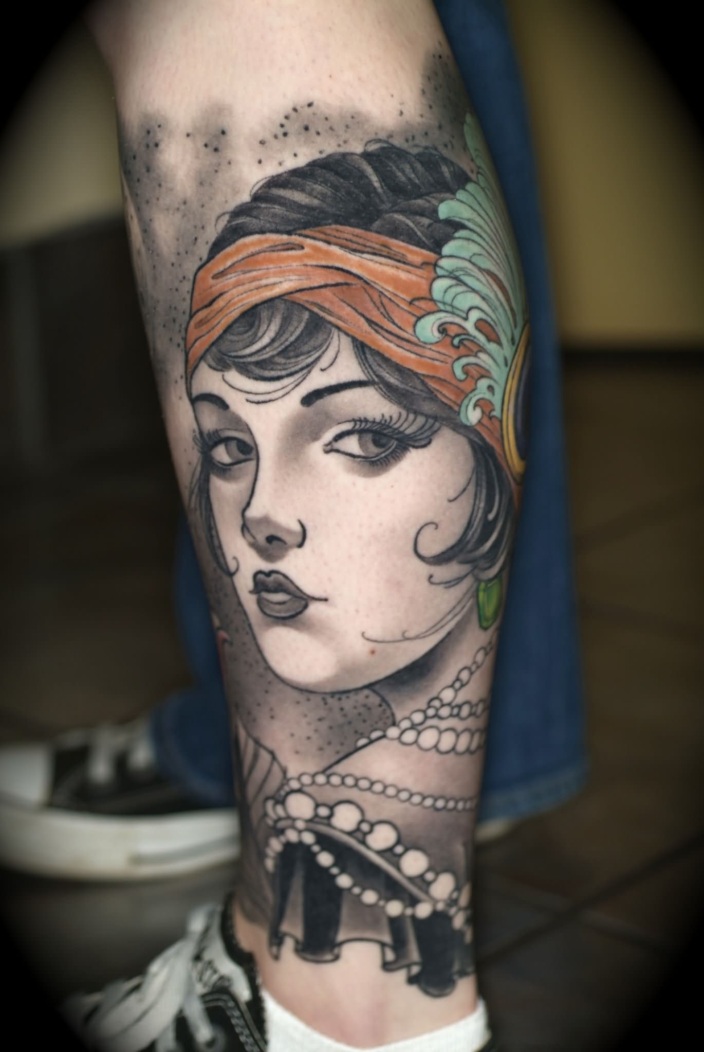 4944a8601d85b Black And Grey Girl Face Tattoo On Left Leg