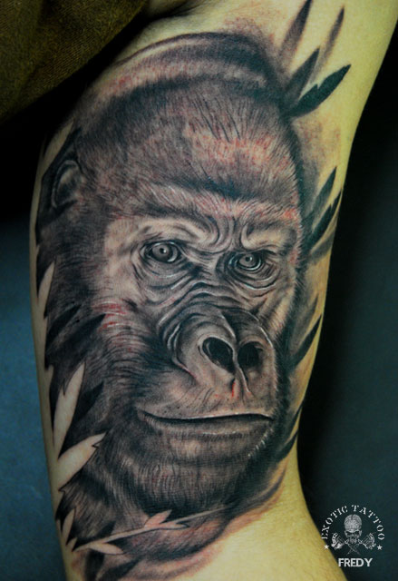 Black And Grey Gorilla Head Tattoo On Left Bicep