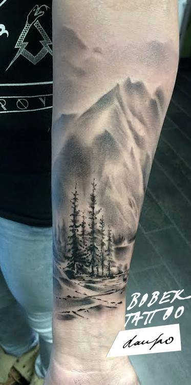 Black And Grey Trees With Mountains Tattoo On Forearm