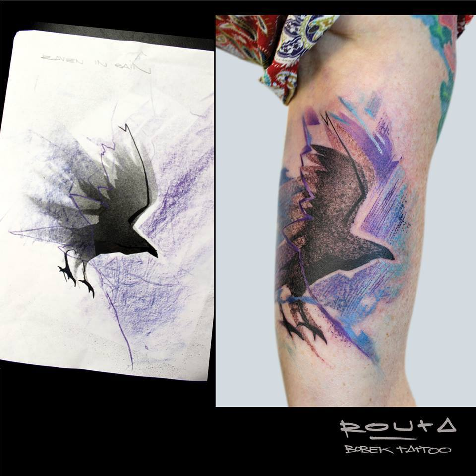 Black Ink Abstract Flying Bird Tattoo On Left Bicep