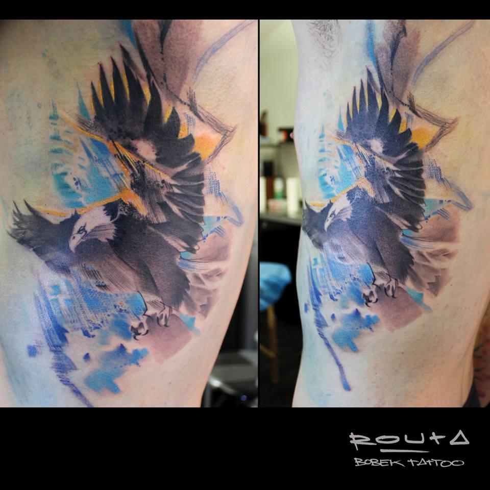 Black Ink Abstract Flying Bird Tattoo On Left Side Rib