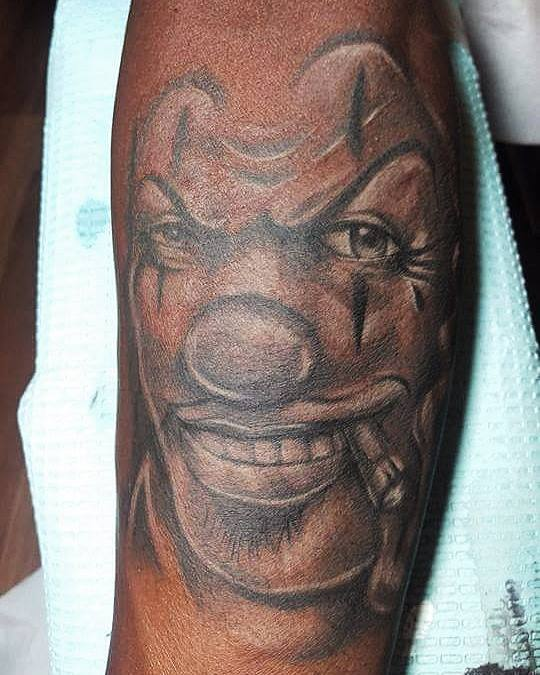 Black Ink Clown Face Tattoo Design For Sleeve