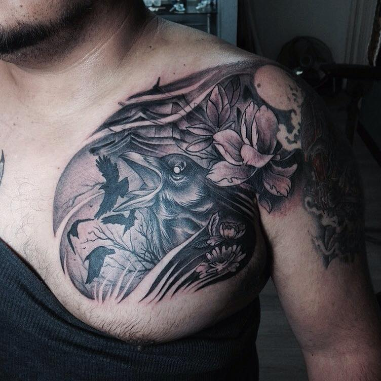 Black Ink Crow With Flowers Tattoo On Man Left Front Shoulder
