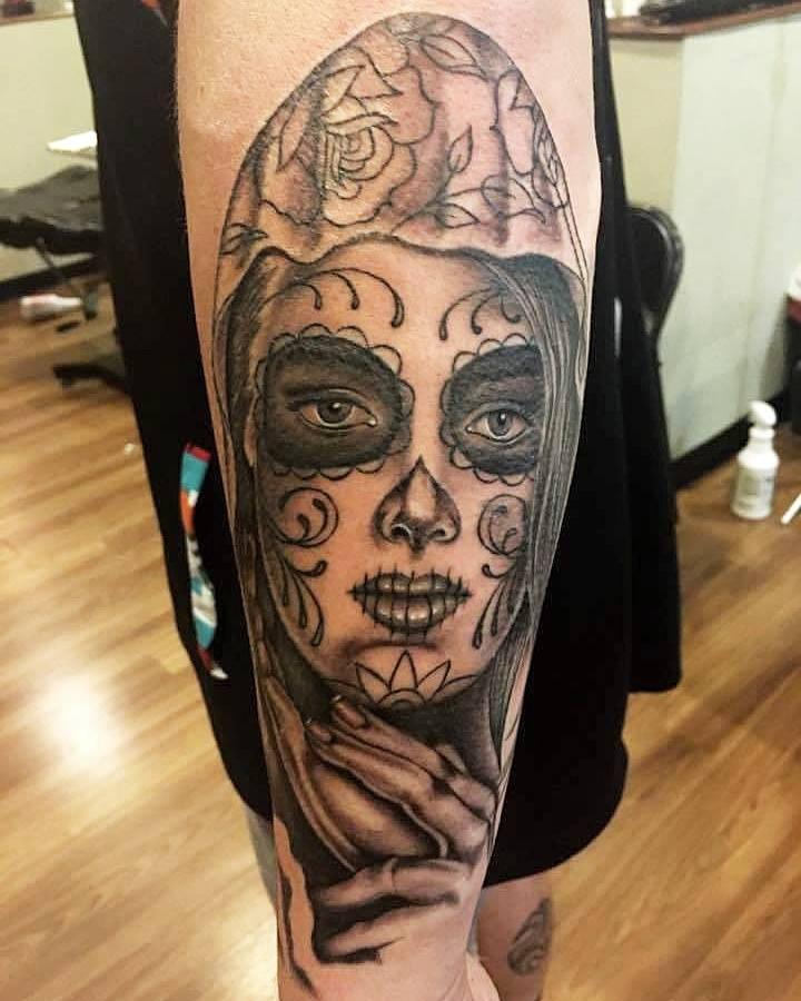 Black Ink Dia De Los Muertos Girl Face Tattoo On Left Arm
