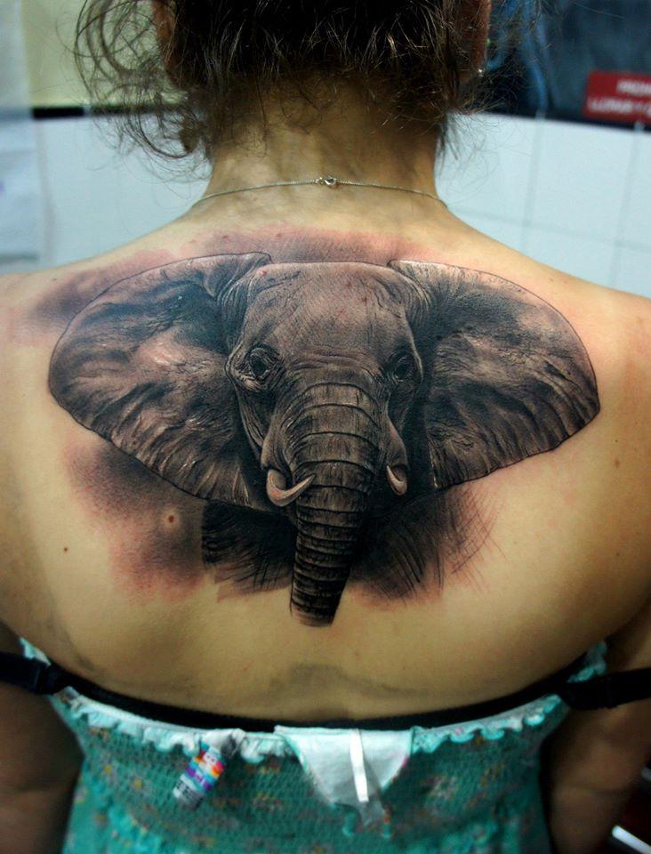 Black Ink Elephant Tattoo On Women Upper Back