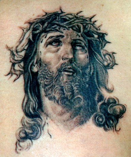Black Ink Jesus Christ Face Tattoo Design