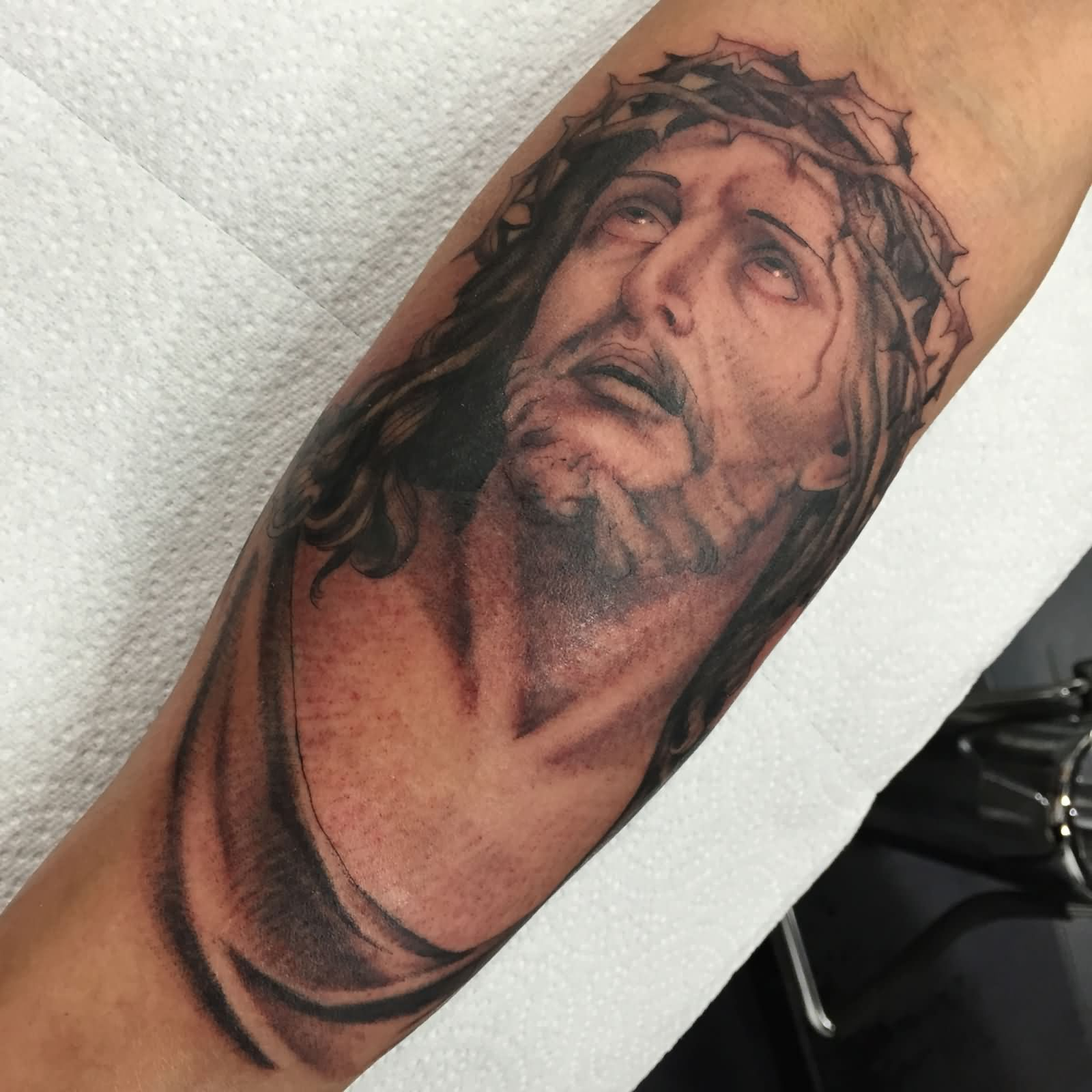 18 awesome forearm tattoos designs for Tattoos of black jesus