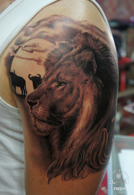 Black Ink Lion Head Tattoo On Left Shoulder