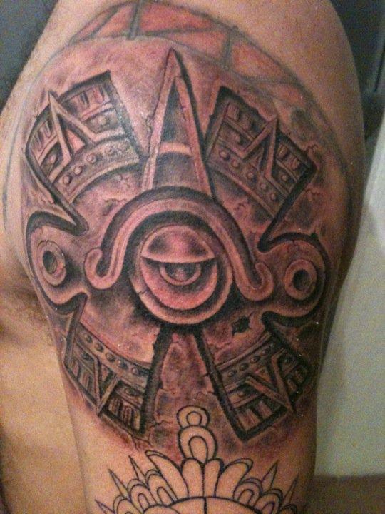 Black Ink Ollin Aztec Symbol Tattoo On Man Left Shoulder