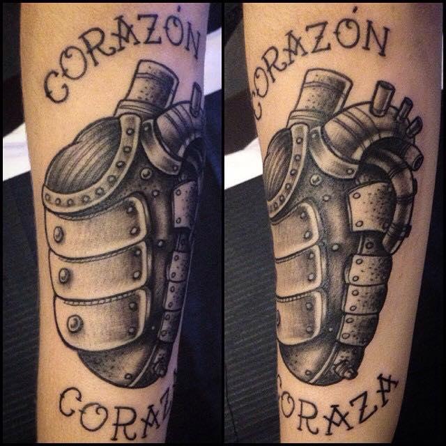 Black Ink Real Heart Grenade Tattoo On Left Arm