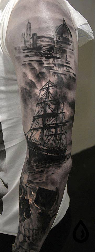 black ink ship with skull tattoo on left full sleeve