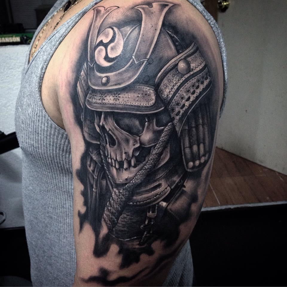Black Ink Warrior Skull Tattoo On Man Left Half Sleeve
