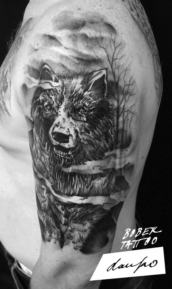 Black Ink Wolf Tattoo On Man Left Half Sleeve
