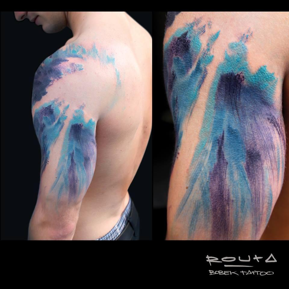 Blue Ink Wave Tattoo On Man Left Half Sleeve