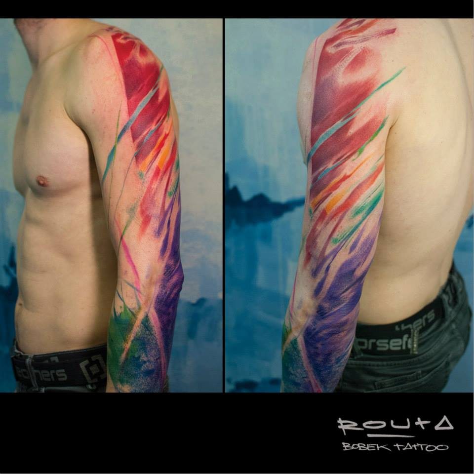 Colorful Abstract Tattoo On Man Left Full Sleeve