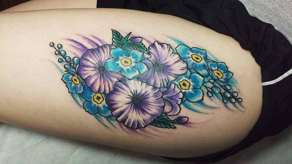 Colorful Flowers Tattoo On Left Side Thigh