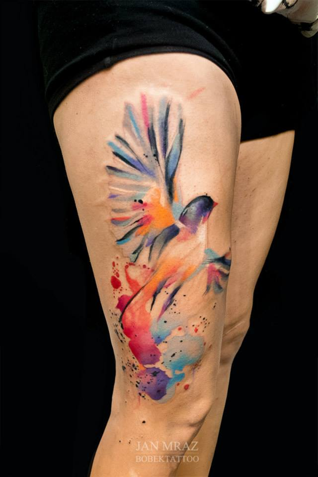 Colorful Flying Bird Tattoo On Right Side Thigh