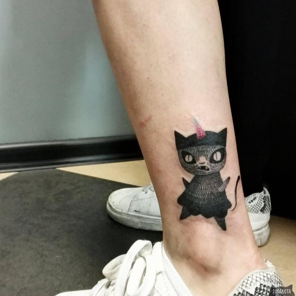 Cool Black Ink Cat Tattoo On Left Leg