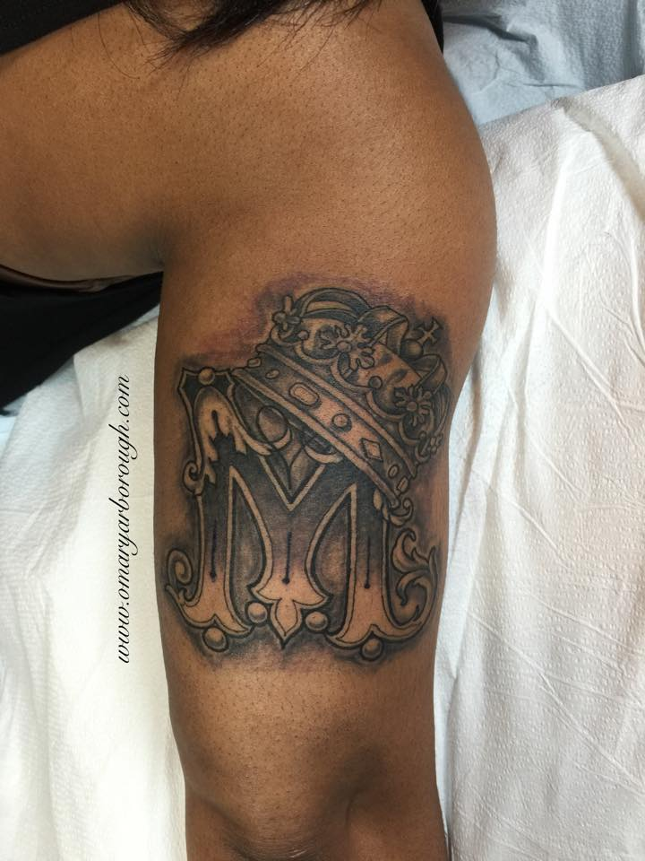 crown on m letter tattoo on right half sleeve. Black Bedroom Furniture Sets. Home Design Ideas