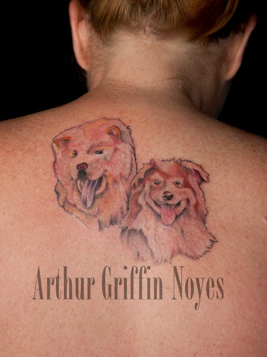 Cute Two Dogs Tattoo On Upper Back