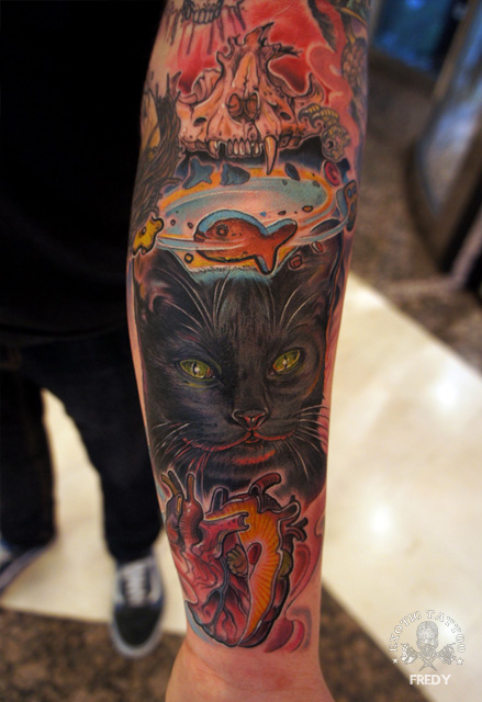 Evil Cat With Real Heart Tattoo On Forearm