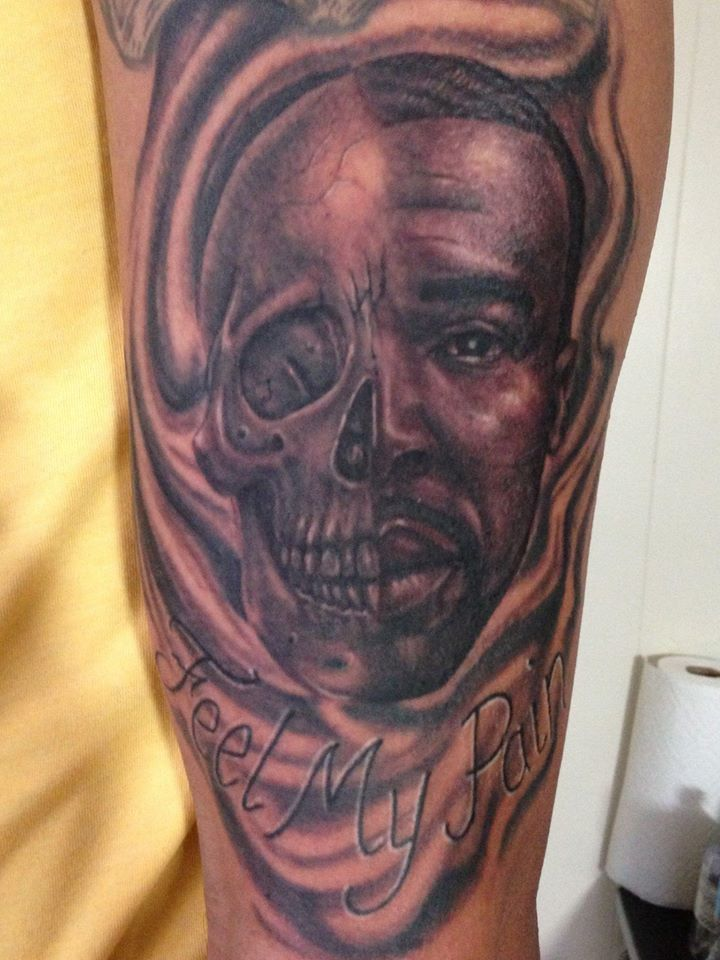 Feel My Pain Black Ink Man Face With Half Skull Tattoo On Right