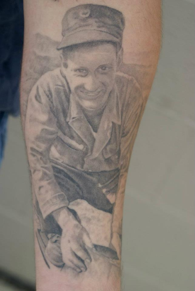 Grey Ink Man Portrait Tattoo On Left Forearm