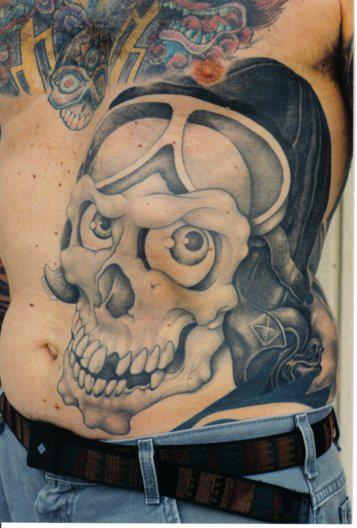 Grey Ink Skull Tattoo On Man Stomach