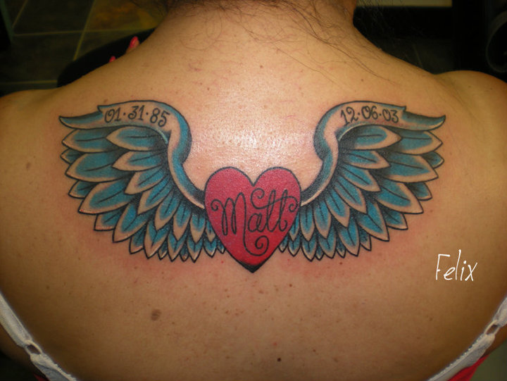 Memorial Heart With Wings Tattoo On Women Upper Back