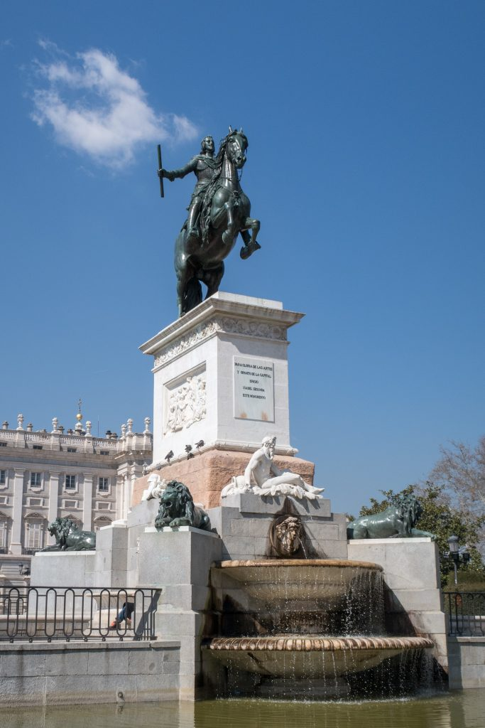 Royal Statue In Front Of Royal Palace Of Madrid