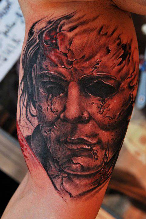 Scary michael myers tattoo on right bicep for Michael myers tattoo