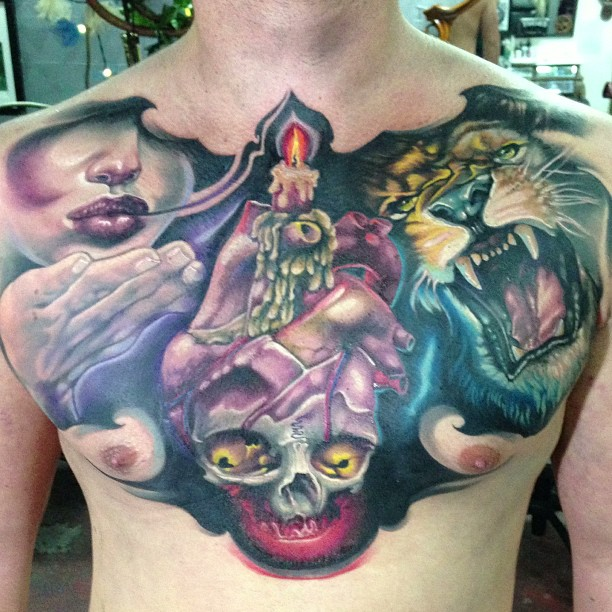 Skull With Real Heart And Roaring Lion Head Tattoo On Man Chest