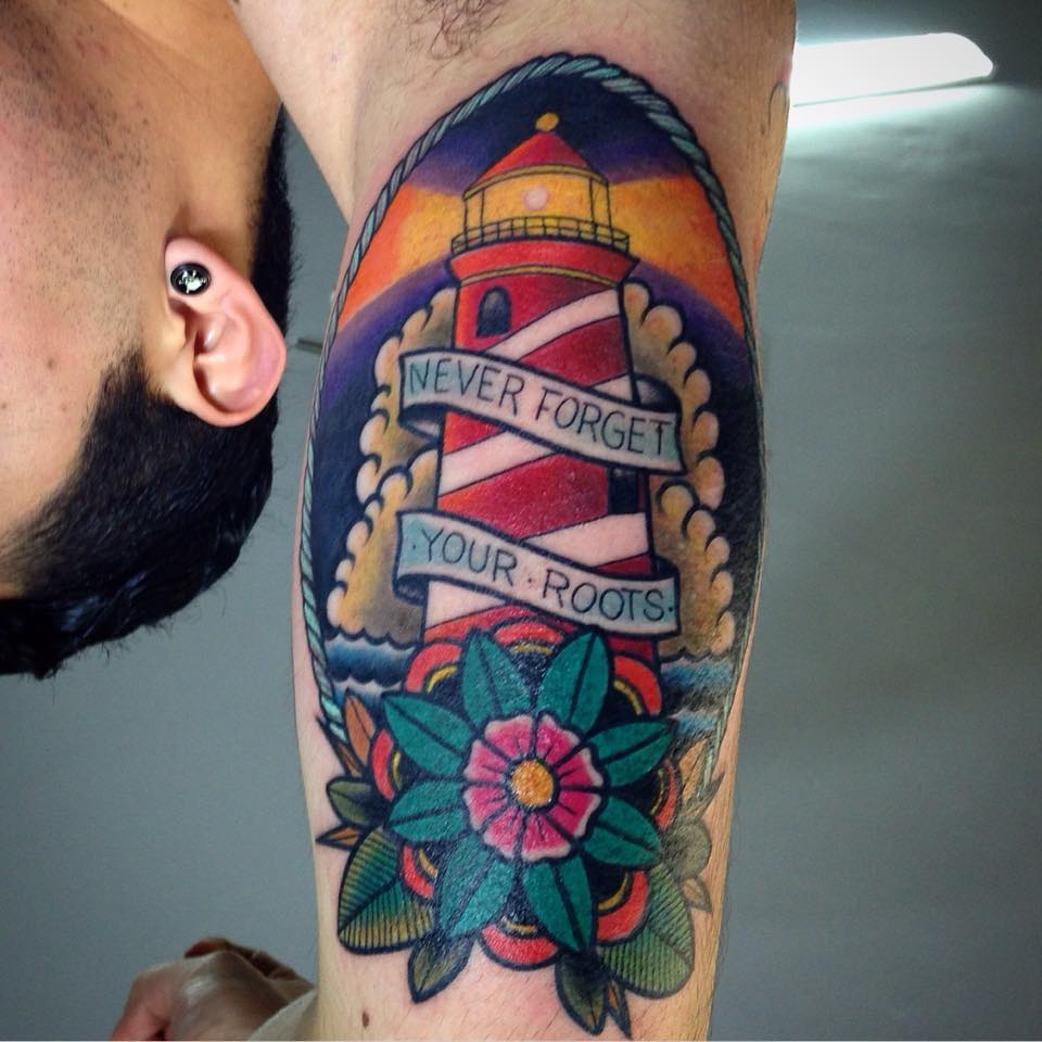 be1ef6e3d Traditional Lighthouse With Banner In Rope Frame Tattoo On Man Right Bicep