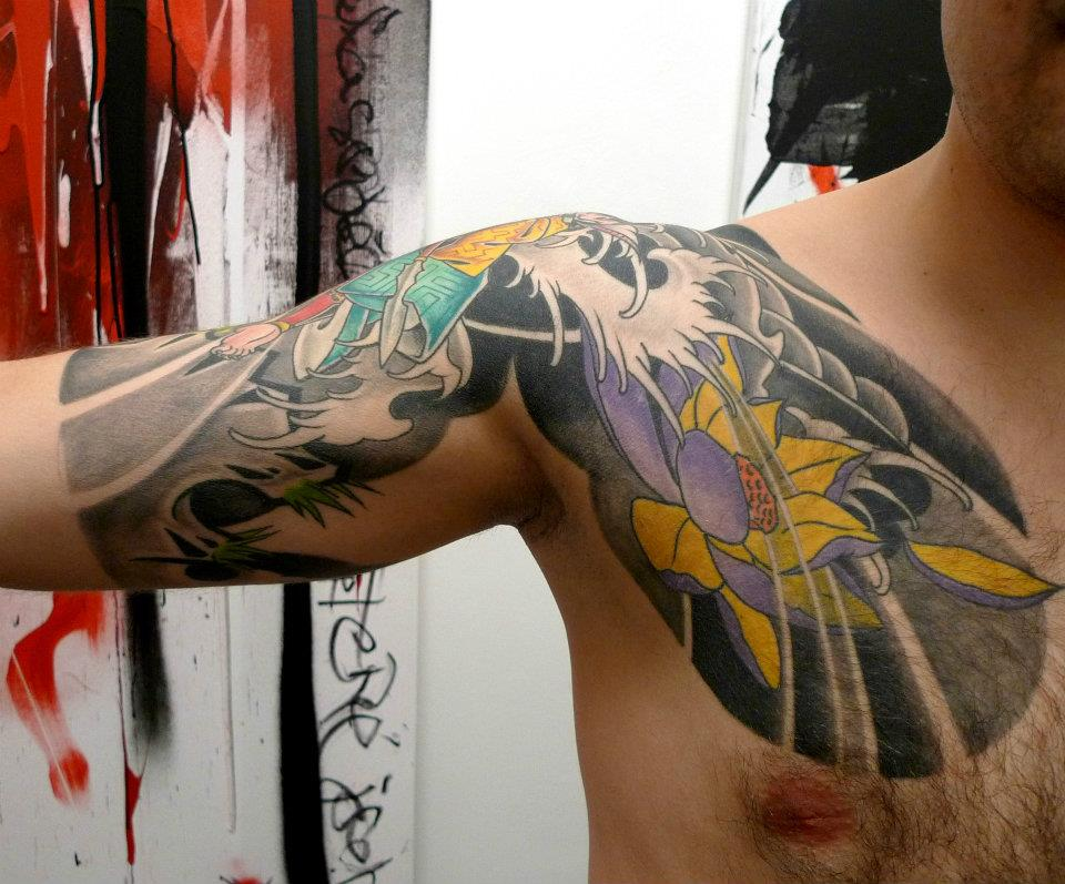 Traditional Lotus Flower Tattoo On Man Right Front Shoulder
