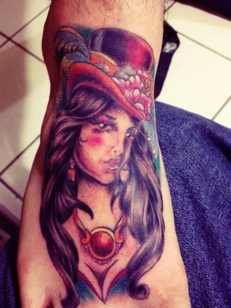 Traditional Women Tattoo On Right Foot