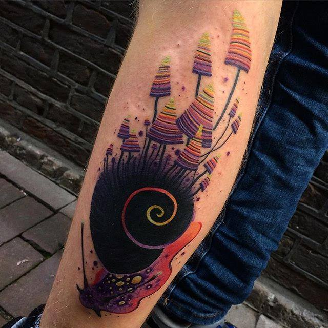 Unique Abstract Snail Tattoo On Left Leg