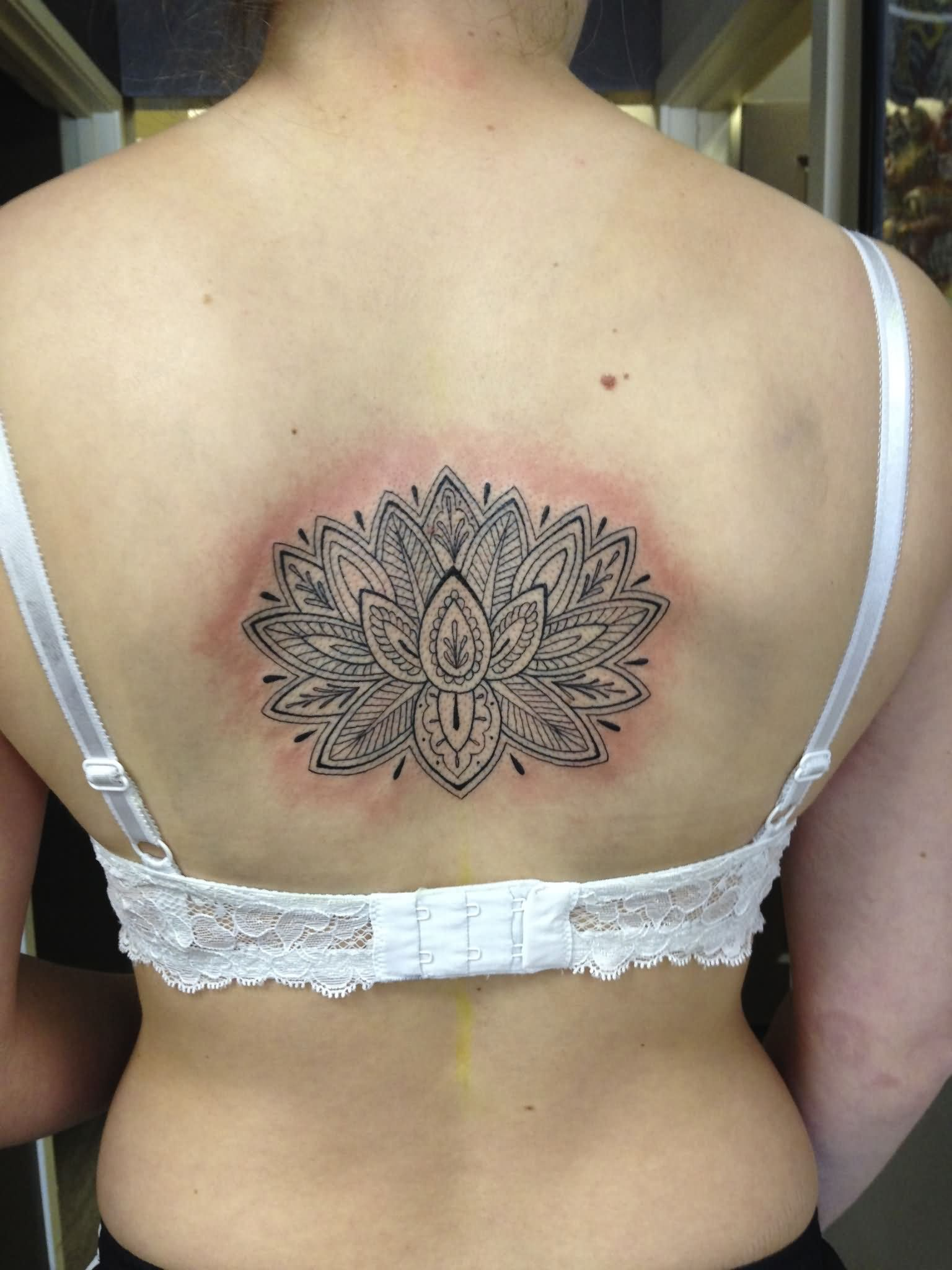 Unique Lotus Flower Tattoo On Women Upper Back