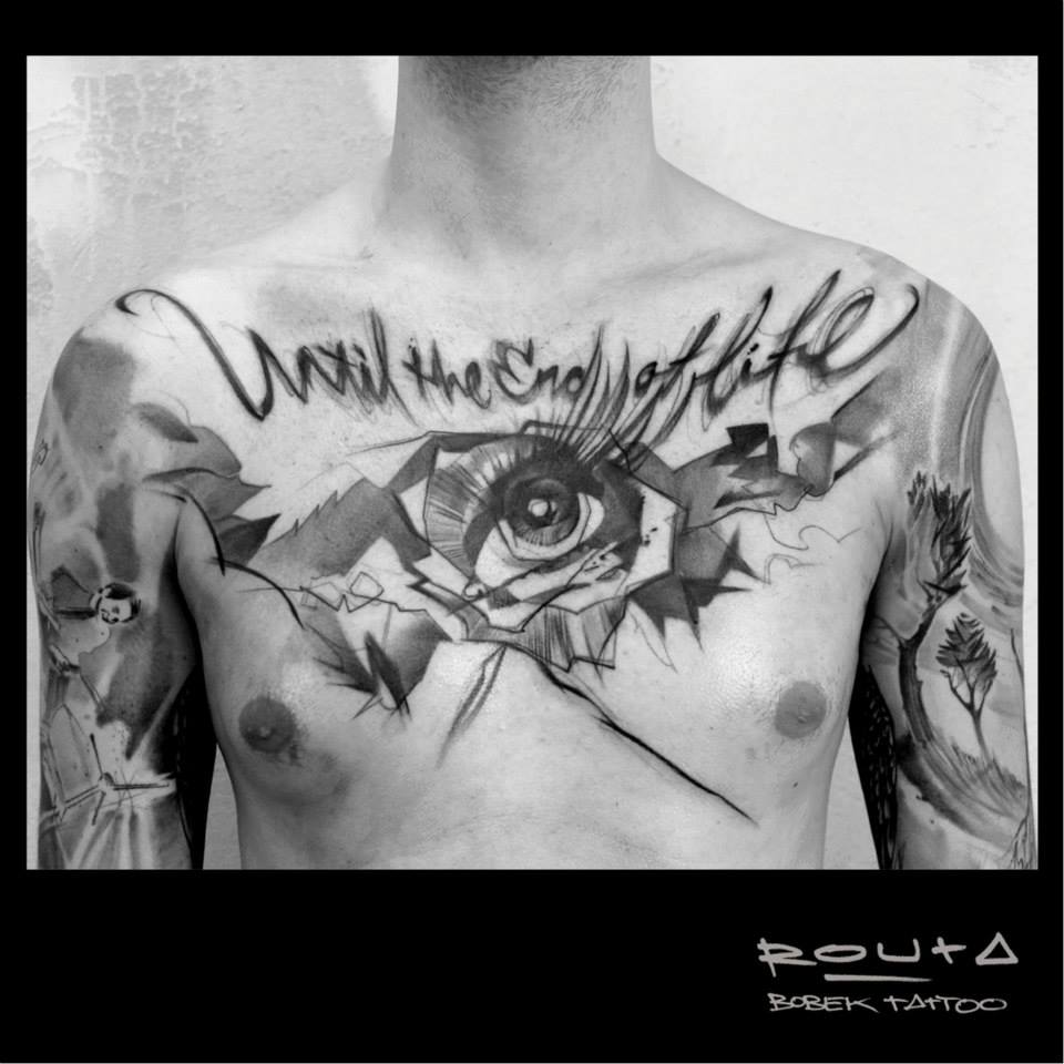 Until The End Of Life – Black Ink Abstract Eye Tattoo On Man Chest