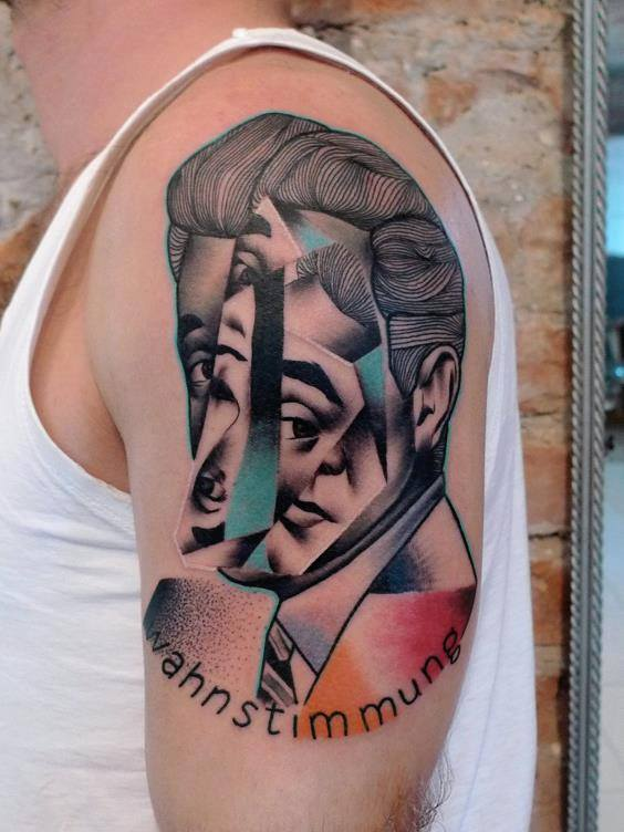 Abstract Man Face Tattoo On Left Shoulder